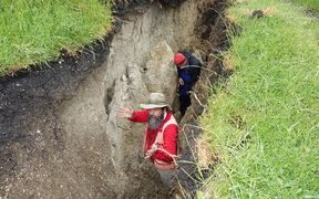 Russ Van Dissen and Jamie Howarth take samples from a giant chasm created by the quake on a Ward farm.