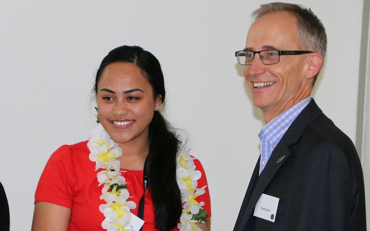 Tupu Tai intern Robyn Lesatele is congratulated by MBIE CEO David Smol