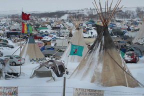 Snow covers Oceti Sakowin Camp near the Standing Rock Sioux Reservation on November 30, 2016 outside Cannon Ball, North Dakota. Native Americans and activists from around the country have been gathering at the camp for several months trying to halt the construction of the Dakota Access Pipeline.