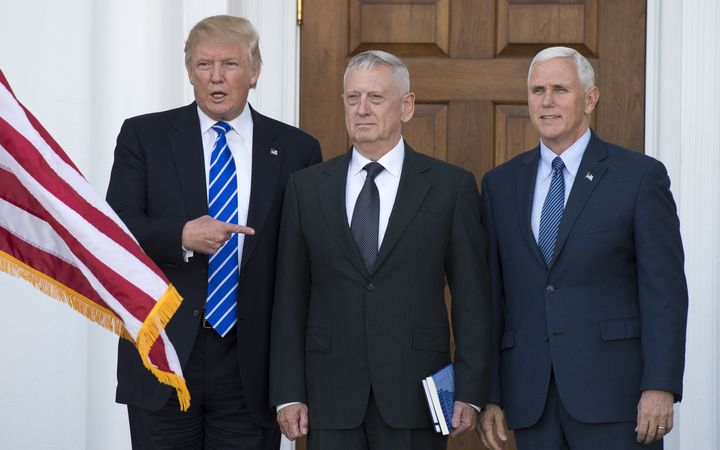 US President-elect Donald Trump with US Marines General James Mattis and Vice-President-elect Mike Pence.