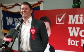 Michael Wood takes the stage after being named the winner of the Mt Roskill by-election.