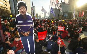 Protesters carry a portrait of South Korea's President Park Geun-Hye during a rally.