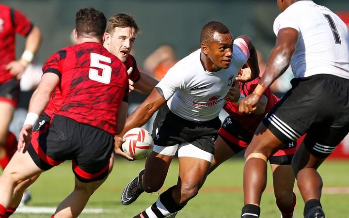 Fiji captain Osea Kolinsau finds space during the Dubai 7s.