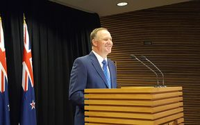 John Key announces his resignation