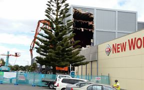 The demolition of the Queensgate Mall begins.