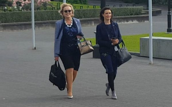 Police Minister Judith Collins, left, arrives at Parliament.