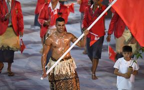 Tonga's flagbearer Pita Nikolas Taufatofua leads his delegation during the opening ceremony of the Rio 2016 Olympic Games.