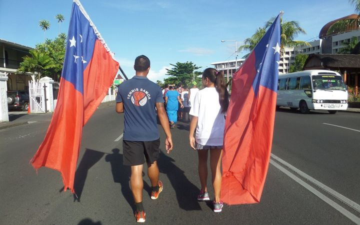 Athletes march through Apia ahead of the opening ceremony for the Samoa Games.