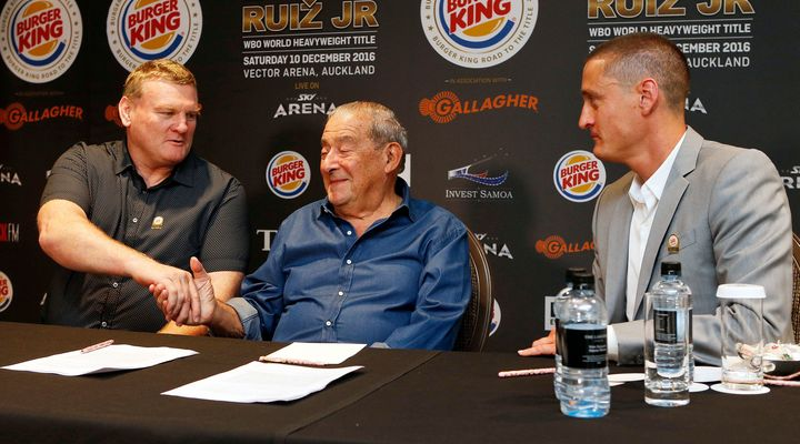 Duco co-director Dean Lonergan (L) shakes hand's with Top Rank CEO Bob Arum (C) along with Duco co-director David Higgins.