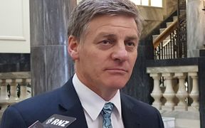 Bill English talks to reporters shortly after Jonathan Coleman pulled out of the leadership race.