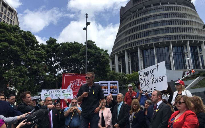 Families of the Pike river mine disaster victims and their supporters gathered outside parliament to release a new plan for entering the mine.