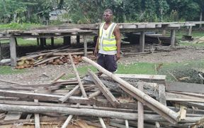 A Solomon Islands Red Cross worker surveys damage following the 7.8 magnitude earthquake on 9 December 2016