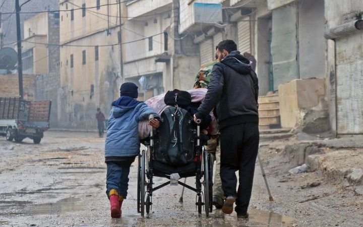 Syrian civilians leave towards safer rebel-held areas in Aleppo during an operation by Syrian government forces to retake the embattled city.
