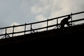 Silhouette of a construction worker