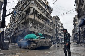 Syrian pro-government forces advance in the Jisr al-Haj neighbourhood during the ongoing military operation to retake remaining rebel-held areas in the northern embattled city of Aleppo on December 14, 2016.