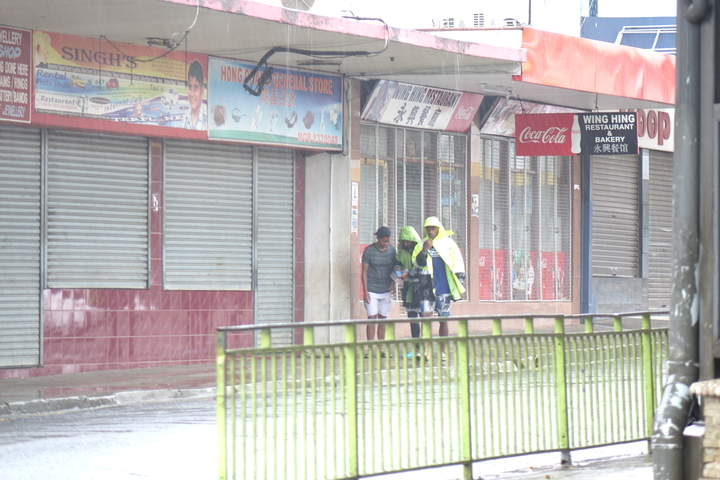 Sheltering from the rain in downtown Nadi, Fiji.