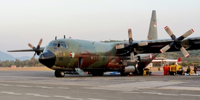 An Indonesian Air Force C-130 on the at Langkawi International Airport flightline.