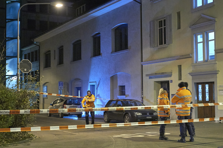 Police outside the prayer hall in central Zurich where three people were injured in a shooting.