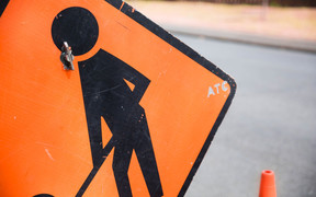 Close up of a road works sign