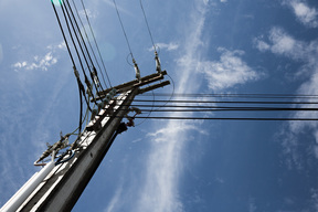 Power lines against a bright blue sky.