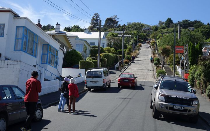 A constant stream of tourists travels up the world's steepest street, Dunedin's Baldwin Street, each day.