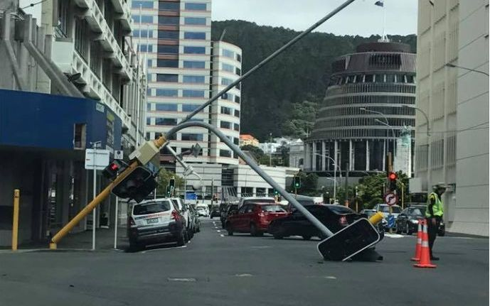 Traffic lights at a Wellington intersection have toppled onto the road.