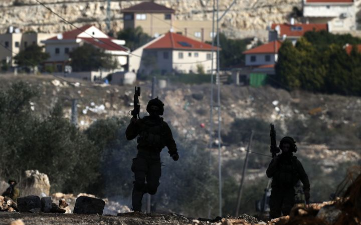Israeli security forces taking position near the settlement of Kadumim (background) during clashes following a demonstration against the expropriation of Palestinian land by Israel.