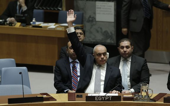 Amr Abdel Latif Aboulatta, Permanent Representative of Egypt to the UN, votes in favor of the ban on Israeli settlements.