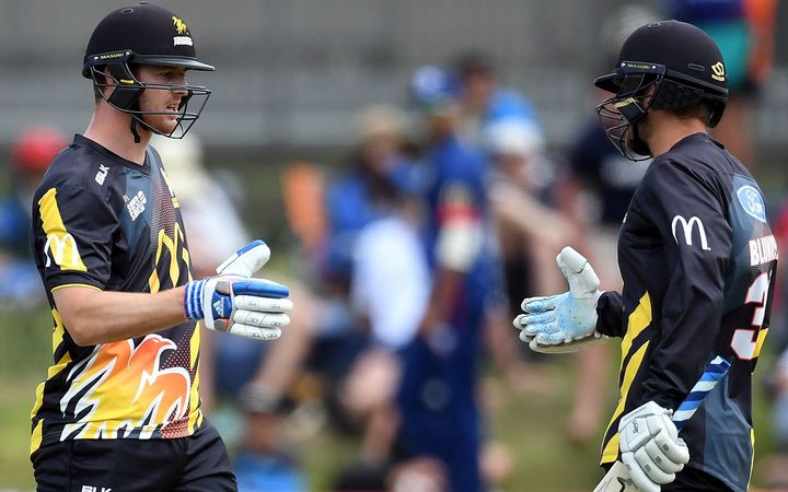 Wellington Firebirds Tom Blundell and Michael Pollard celebrate their 100 partnership