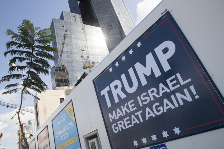 A placard in the Israeli city of Tel Aviv. Donald Trump had pressed for the US to use its veto to prevent a UN Ssecurity Council resolution condemning Israeli settlements from passing.