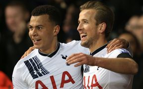 Harry Kane (R) of Tottenham Hotspur celebrates scoring with Dele Alli.
