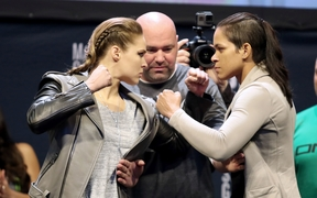 Ronda Rousey (L) and Amanda Nunes face off ahead of UFC title fight
