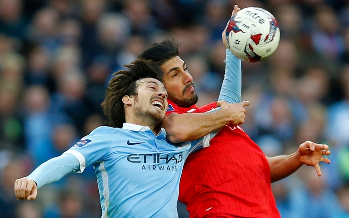 David Silva of Manchester City in action with Emre Can of Liverpool during the 2016 Capital One Cup Final.