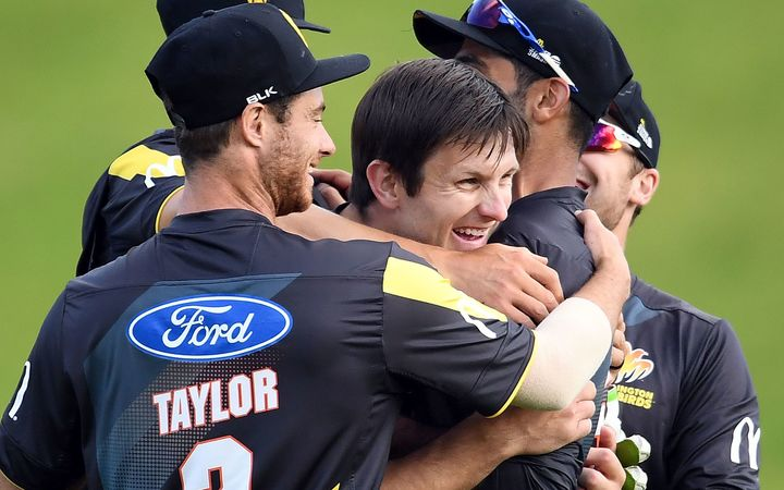 Wellington players mob Hamish Bennett after their victory