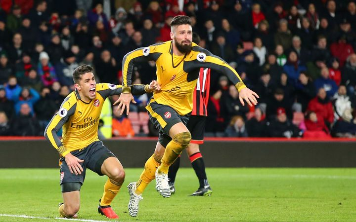 Olivier Giroud (R) and Gabriel Paulista of Arsenal celebrate a goal.