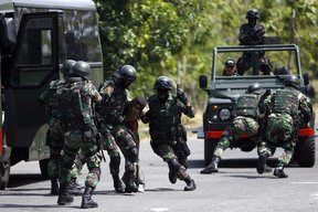 Members of Indonesian special forces group Kopassus take part in a simulated hostage bus hijacking drill in their headquarters complex in Kandang Menjangan, Sukoharjo, Central Java in September 2013.