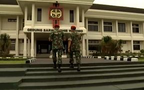 Indonesian military enter the Sarwo Edhie Wibowo centre in Jakarta.
