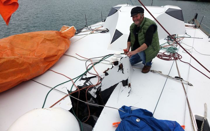 Yachtsman Enda O'Coineen with the damage to his yacht, the Kilcullen Voyager.