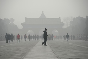 A man walks through smog at a the Temple of Heaven park in Beijing last month.