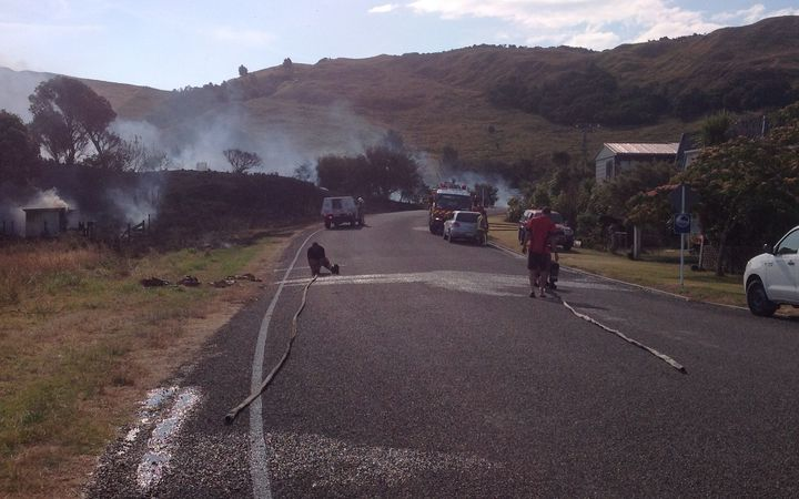 Photo shows how close fire got to houses, with just the road in between.