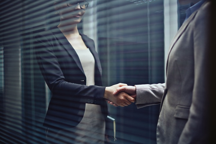 two businesswomen handshaking