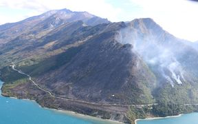 Helicopters have been used to battle the Glenorchy blaze.
