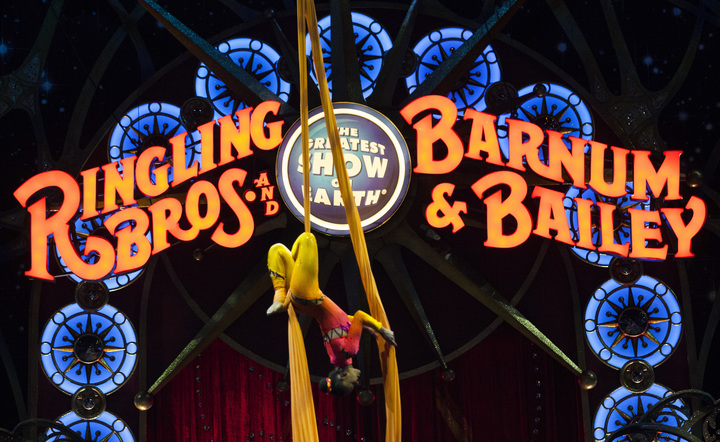 A circus performer hanging upside down during a Ringling Bros. and Barnum & Bailey Circus performance in Washington, DC