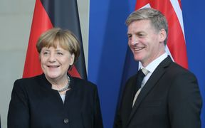 German Chancellor Angela Merkel and Prime Minister Bill English at a media conference after their meeting in Berlin.