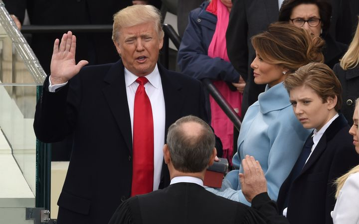 Donald Trump is sworn in as the 45th US president by Supreme Court Chief Justice John Roberts.