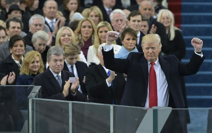 Donald Trump acknowledges the crowd during his swearing-in ceremony.