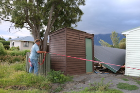 Tony Guthrie at his earthquake-damaged home beside Lyell Creek.