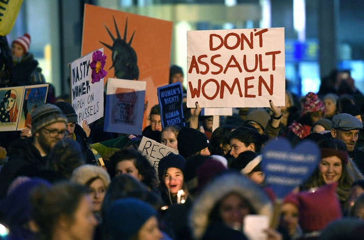 People gather for 'Lights for Rights', the Brussels Women's march, in Brussels, at the same time as the inauguration of US President Donald Trump.