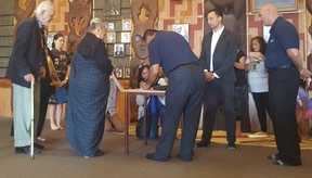 Joe Hawke, left, signs for Ngāti Whātua while Ngati Paoa lead negotiator, Hauauru Rawiri signs for Ngāti Paoa followed by other kaumatua and kuia.