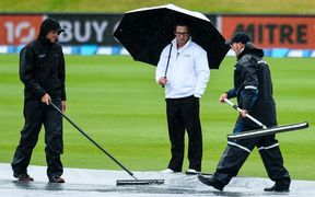 3rd Umpire Marais Erasmus checks out the wicket block with the groundsman.